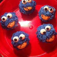 Cookie Monster Cupcakes Cookie Monster Cupcakes. Chocolate chip cookie baked inside. Buttercream and Fondant. Real cookie in mouth!
