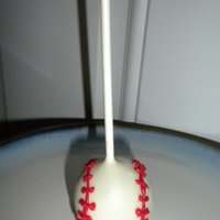 Baseball Theme Boy's Baby Shower Favors chocolate brownies with raspberry and dipped in white chocolate.