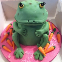 A Green Frog With 18 Carrots