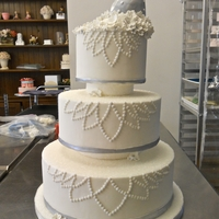 "Winter Wonderland.   Styro Dummy wedding cake for class.Inspired by a tiara for the pattern. The topper is a ""christmas ornament"""