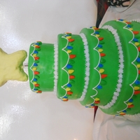 Christmas Tree Cake 4 tier cake made to resemble a christmas tree. Star is RK with white chocolate and fondant