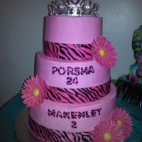 Zebra Print Birthday Mother/daughter shared birthday cake. Gumpaste flowers, Fondant letters. Buttercream frosted.