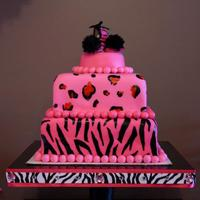 Animal Print Themed Baby Shower Cake Covered in fondant.