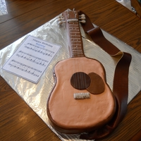 Guitar Cake   Covered with Marshmallow fondant with royal icing trim. Leather guitar strap