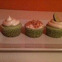 Key Lime Pie Cupcakes Key lime cupcakes, some topped with toasted coconut, others with a fresh lime slice ,and other with graham cracker crumbs.