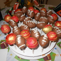Football Cake Pops I made these for a 49er fan, They are football cake pops and regular cake pops in the 49er colors!