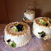 Plumeria Wedding Cake This is my first time doing a wedding cake! The bride wanted plumeria flowers in black, green, and white. The cake is covered in...