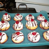 Sunday Cupcakes! Strawberry whipped cream cupcakes with a cherry on top and a chocolate ganache drizzle!
