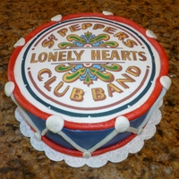Sgt. Pepper Drum Buttercream icing with MMF accents. Sgt. Pepper logo done via printer with edible paper/ink
