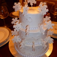 Snowflake Cake Buttercream icing with Gum Paste snowflakes. Inside cake is red & green tie-dye design, for a nice little surprise upon serving.