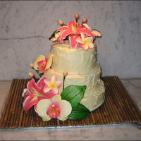 Tropical Flower Cake A gluten-free 3-tiered cake made for a yoga studio staff party. Went for a plaster-look rough cream cheese icing and filling on a vanilla...