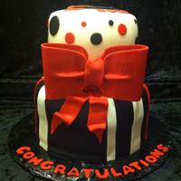 Class Of 2014 Client requested a 2 tiered graduation cake with stripes, polka dots & a BIG bow. School colors were red, black and white. Thanks for...