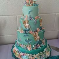 Four Tier Mermaid And Coral Cake For A Baby Shower Four tier mermaid and coral cake for a baby shower.