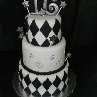 "Black And White 16Th Birthday Cake For Boy black and white cake with diamond shapes and disco dust accents on the stars and the ""16"""