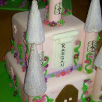 Raegan's Castle Castle Cake with fondant flowers and ice cream cones for the tops of the towers.