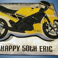 Yellow Motorcycle Cake I decided to go 2D vs 3D this time because honestly...a 3D bike seems crazy hard! I'm glad I went that route though, it's cleaner...