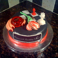 Twilight Book Cake Themed after the 4 book covers for the Twilight series. Book 1: apple being held. Book 2: wilting flower. Book 3: torn ribbon. Book 4:...
