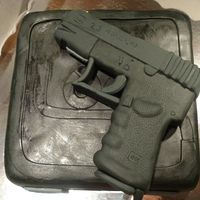 Glock Cake For my boyfriend's father. :) Gun is Styrofoam covered in fondant, all the others are a cake base.
