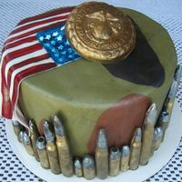 Military Themed Cake For A 13 Year Old Boy   This was fun to make! All fondant except for the Marines emblem- it's chocolate with gold luster dust.