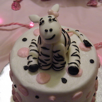 Zebra Cake Buttercream frostig with fondant accents zebra and zebra stripes.