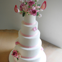 Pink And White Wedding Cake  im super proud of this one. 3 tiers are pink velvet with chocolate ganache filling and cream cheese icing and 2 are strawberry cake with...