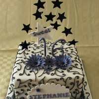 Sweet 16 Birthday Cake White fondant with scroll work done in black royal icing. Purple gumpaste flowers and black stars