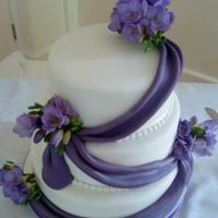 Purple Swag Cake With Freesias
