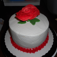 "My First Fondant/gumpaste Rose Client asked for small 5"" cake with a large red rose on top. After watching a few tutorials on making flowers by hand, I attempted the..."