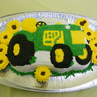 Girls Like Tractors Too! Mini sunflower cupcakes and a tractor were what the birthday girl wanted...that's what she got!