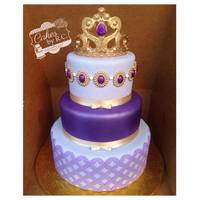 Sofia The First Inspired Cake Different tones of lavender and textures. All edible tiara and gem. Center tier air brushed.