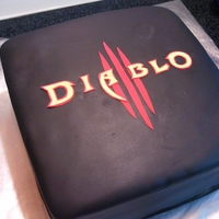 Diablo 3  I made this cake for my store midnight release for a video game Diablo 3. It's a simple 8'' yellow cake with chocolate...