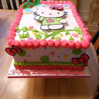 Kitty Cake  Hello Kitty and bows are made using Color Flow by Wilton. Disco dust added to one bow. She's elevated on sugar cubes (have used...
