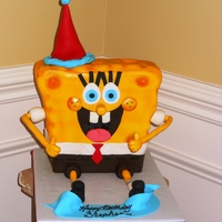 "Spongebob  Bob was 7.5"" x 4"" at the base, 10"" x 4"" at his top and he was about 10"" tall without the hat. He is sitting on an..."
