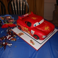 My Big Mcqueen Cake  Made this for my son's 5th birthday this December. It is about 15x11x4.5 inches. Wanted to do all graphics by hand, but just ran out...