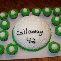Golf Ball Cake   This is a golf ball cake with cupcakes..