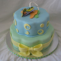 Baby Boy Vanilla with strawberry shortcake filling. Fondant decorations.
