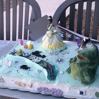 Princess Tiana Cake  Louie the Alligator is fondant covered RKT, Ray the Firefly is gumpaste and a lemonhead. Tiana's dress is cake. the river is colored...