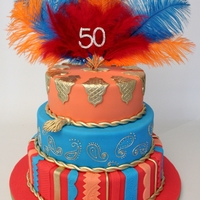 Moroccan Themed Birthday Cake I was asked to create a cake for a Moroccan themed birthday party and she had lots of feathers in bright colours so this is what I came up...