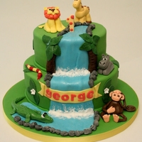 "Jungle Birthday Cake A first birthday cake with sugar modelled ""wild"" animals"