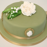 Wedgwood Cake this was a rich fruit cake for a 100th birthday. Her favourite flowers of lily of the valley and rose and she loved cherubs so I made some...