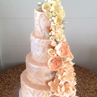 Pink And Cream Sugar Flower Cascade  The cake is covered in fondant and finished with molded and piped lace details. It was then sprayed with a bronze shimmer. All of the sugar...