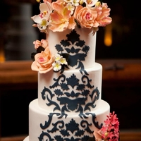 Damask & Sugar Flowers Damask pattern cut from fondant using a variety of cutters. Hand-made sugar flower topper & clusters. (photo by Mark Davidson at the...