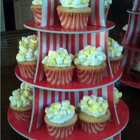 Circus Cupacakes! Popcorn, Get Your Popcorn! Mini-chocolate chip vanilla cupcakes frosted with vanilla buttercream and topped with marshmallow 'popcorn""
