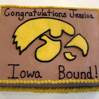 Iowa Bound! Chocolate cake with chocolate whipped cream frosting filling and covering the cake. Hawkeye and wording are buttercream. Hawkeye was...