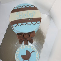 Baby Boy Rattle Nothing fancy here...customer wanted white cake with vanilla buttercream frosting covering and filling the cakes. Fondant accents and...