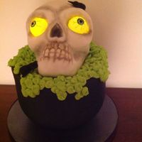 Scary Skull Design from Naoimi Hubert, Tea Party Cakes. I made the skull from RKT with melted chocolate added. This was a fun cake to do.