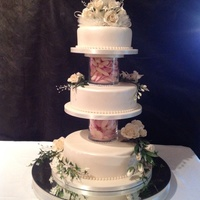 Base Tier Rich Chocolate Middle Tier Vanilla Caramel An Chocolate Caramel Layers Top Tier Fruit Flowers Roses Stephanotis And Dembrodi Base tier Rich chocolate, middle tier vanilla, caramel an chocolate caramel layers, top tier fruit. Flowers, roses, stephanotis and...