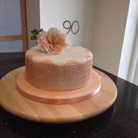 Just Peachy 90th birthday cake using Cake Lace dusted with Sugarflair shimmer peach dust. First attempt at a David Austin rose.