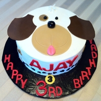 Puppy Face Cake Adorable puppy face cake. It's iced with buttercream and decorations are fondant.