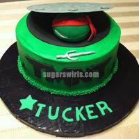 Teenage Mutant Ninja Turtle Cake Buttercream icing with Raphael's head, manhole cover, sai, and logo in fondant.